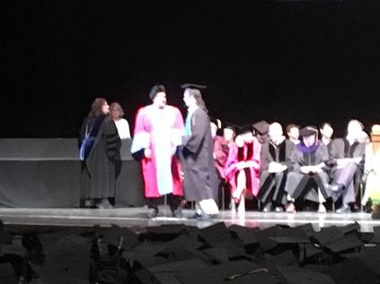 Adam receiving his diploma